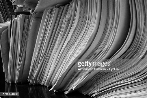 Close-Up Of Piles Of Papers