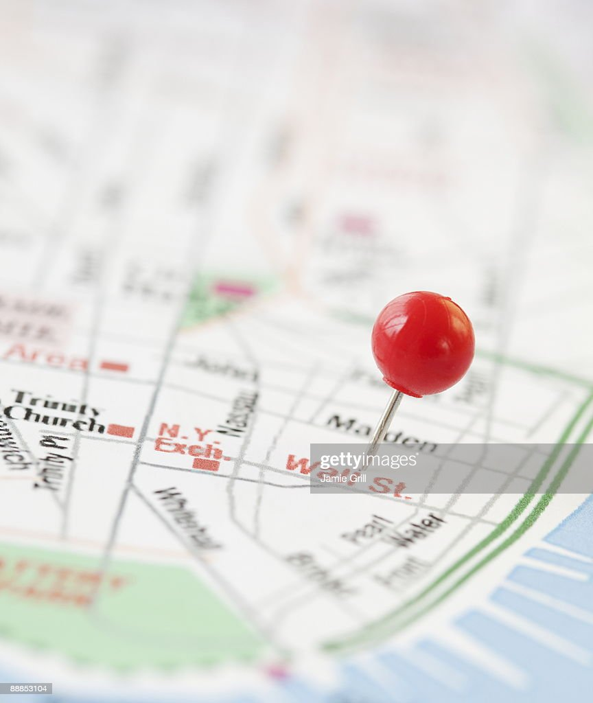 Close-up of pin on wall street map