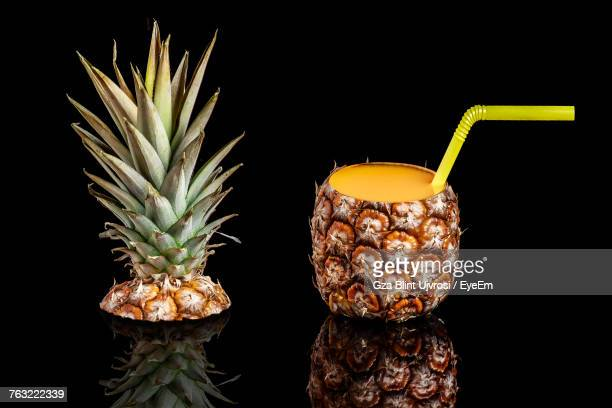 Close-Up Of Pineapple Against Black Background
