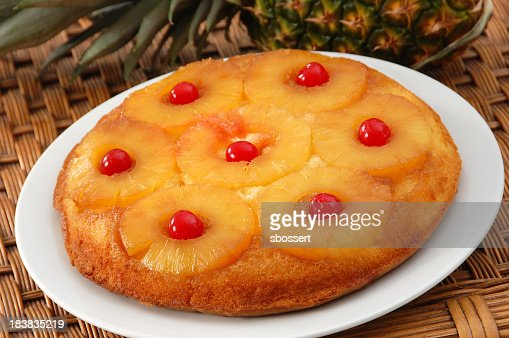 Close-up of pineapple upside down cake on white plate
