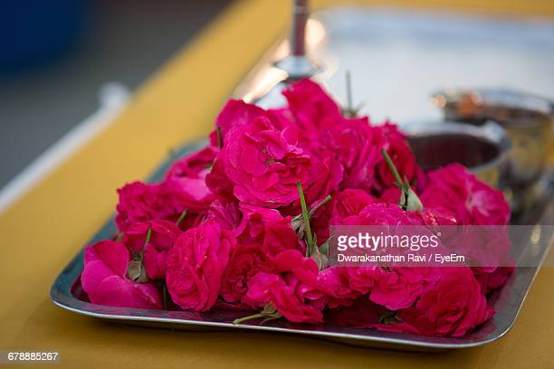 Close-Up Of Pink Roses In Plate On Table