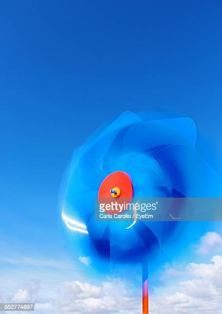Close-Up Of Pinwheel Toy Spinning Against Sky