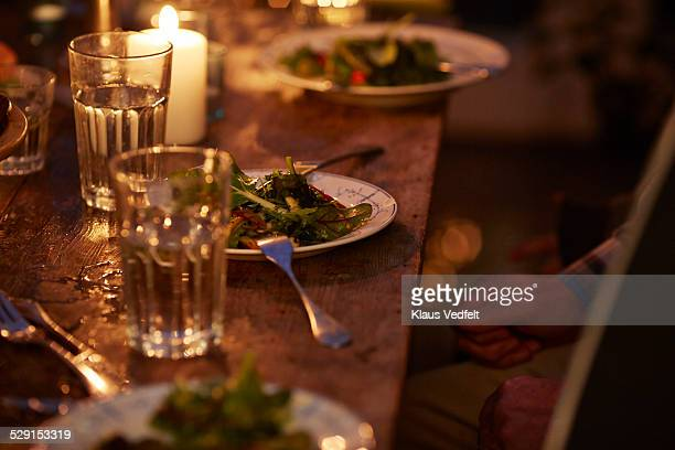 Close-up of plate with organic salad at table
