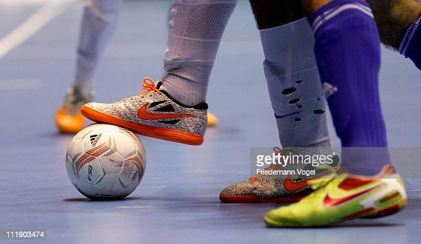 Closeup of players fighting for the ball during the semi final match of the DFB Futsal Cup at the ring arena on April 8 2011 in Nuerburg Germany