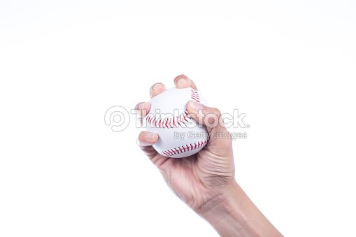 Close-up of player\'s hand holding baseball on white background