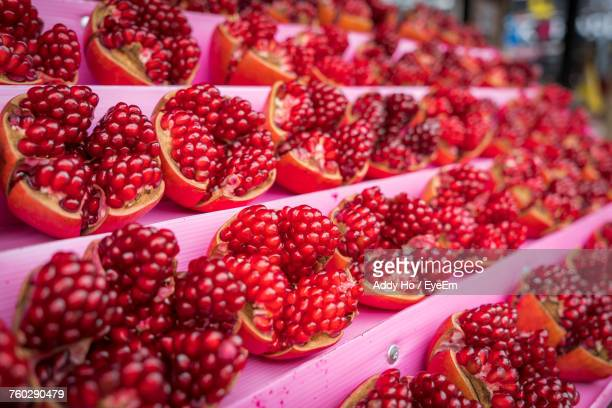 Close-Up Of Pomegranate Arranging On Stall At Market For Sale