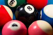 Close-Up Of Pool Balls On A Blue Table - Shallow DOF