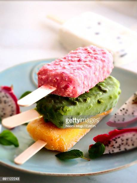 Close-Up Of Popsicles And Dragonfruit Served In Plate