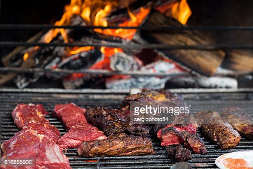 Close-up of pork grilled meat and raw slices on : Stock Photo