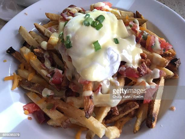 Close-Up Of Poutine Served In Plate