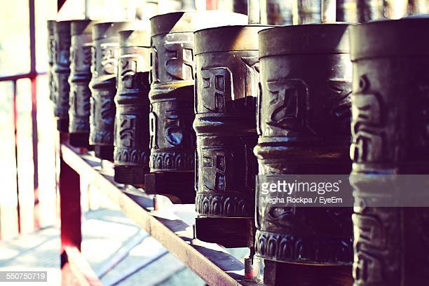 Close-Up Of Prayer Wheels In Row