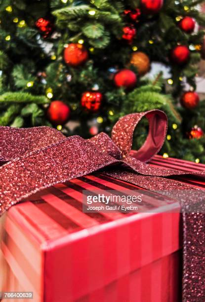Close-Up Of Present Against Christmas Tree