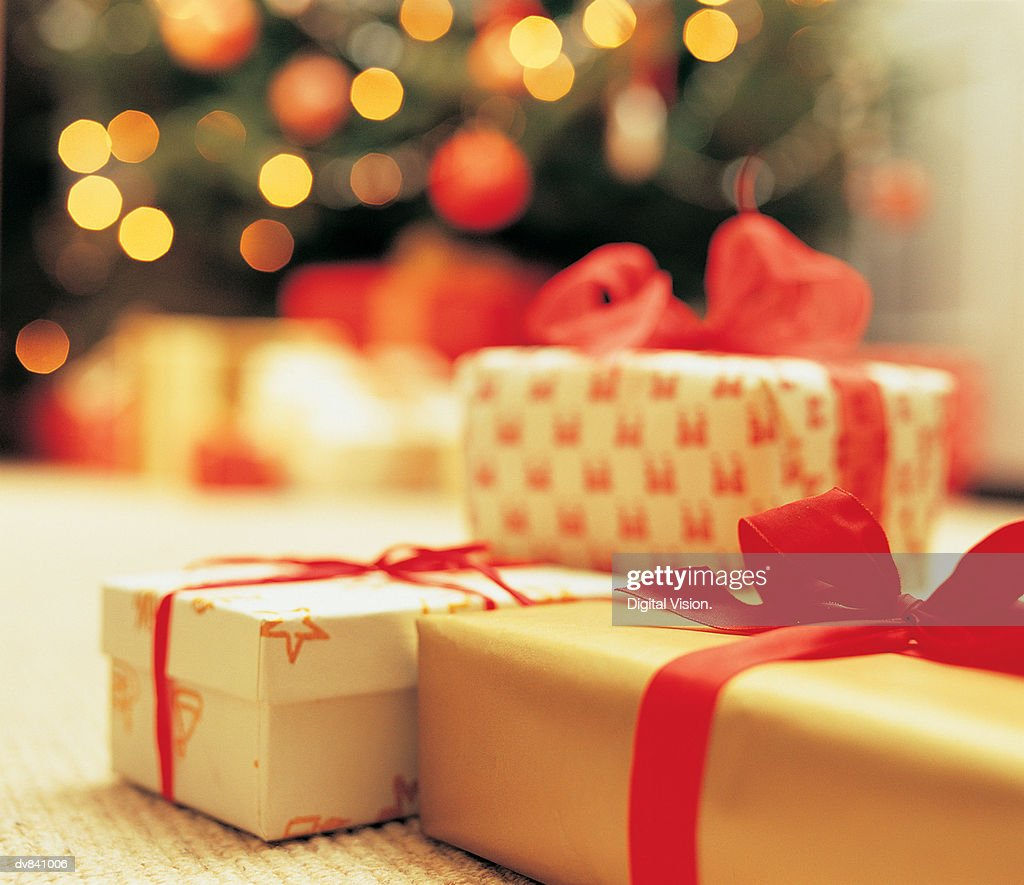 Close-Up of presents with Christmas Tree in background : Stock Photo