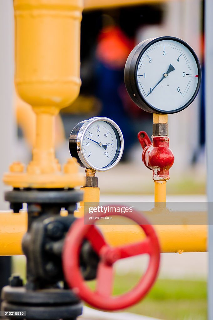 Closeup of pressure meter with Red faucet : Stock Photo