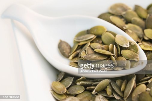 Close-up of pumpkin seeds on a spoon : Stock Photo