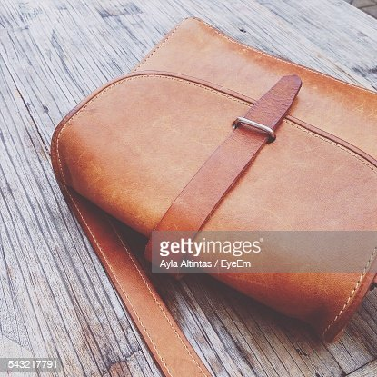 Close-Up Of Purse On Wooden Plank