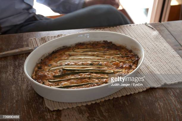 Close-Up Of Quiche On A Wooden Table