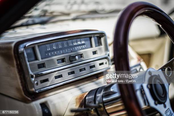 Close-Up Of Radio On Car Dashboard