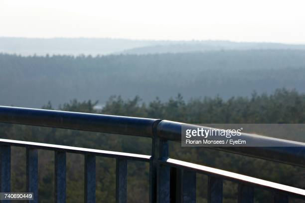 Close-Up Of Railing Against Snow Covered Landscape