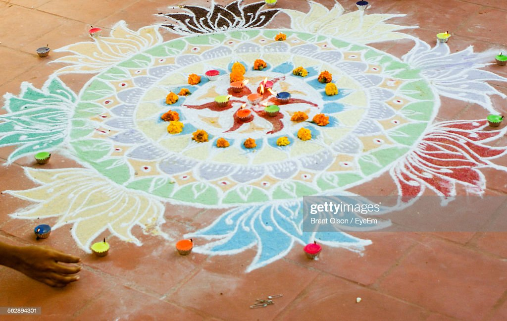 Close-Up Of Rangoli With Diyas