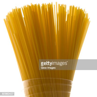 Close-up of raw spaghetti in a glass : Stock Photo