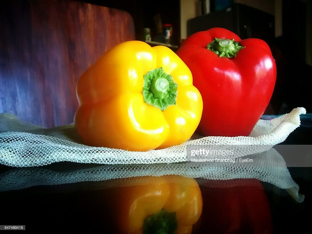 Close-Up Of Red And Yellow Bell Peppers
