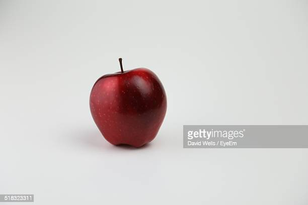Close-up Of Red Apple Over White Background