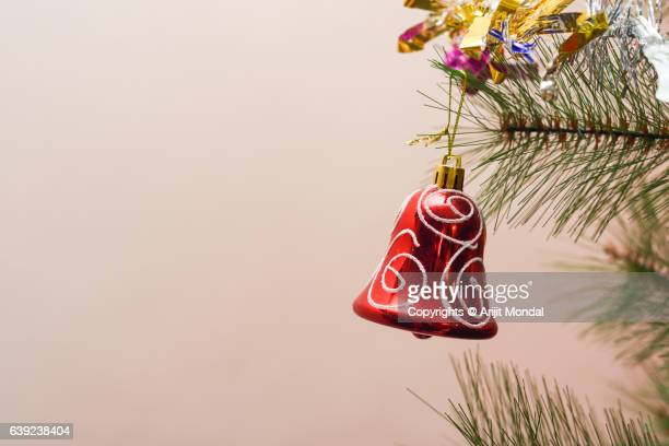 Close-up of Red Bell Hanging On Christmas Tree with Copy Space