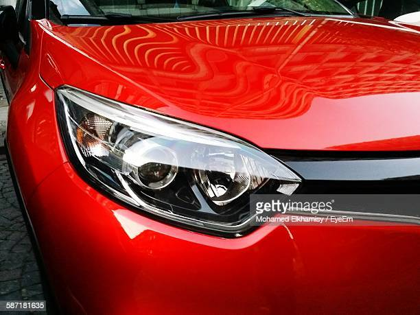 Close-Up Of Red Car Headlight