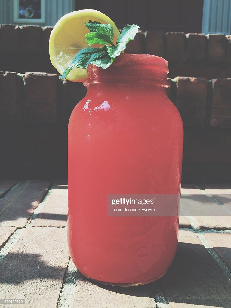 Close-Up Of Red Drink In Jar