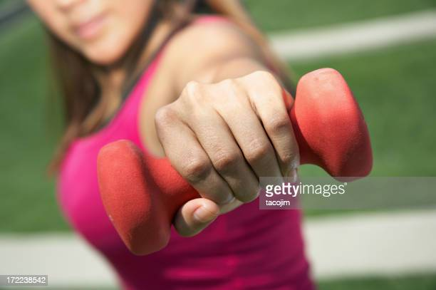 Close-up of red dumbbell being used for body building