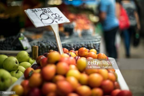 Close-Up Of Red Plums On Stall At Market For Sale