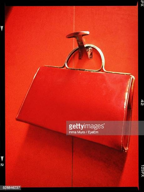 Close-Up Of Red Purse Hanging On Door