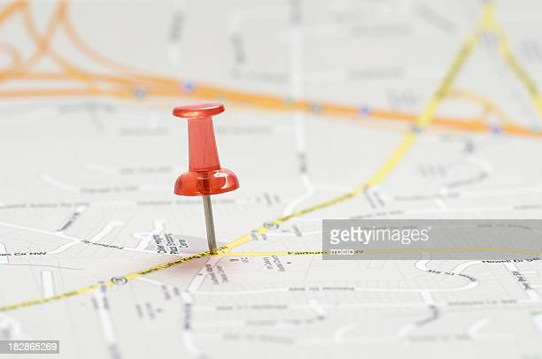 Close-up of red pushpin on a map