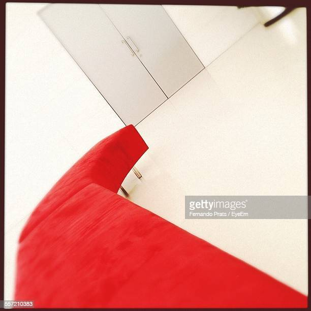 Close-Up Of Red Sofa By Door