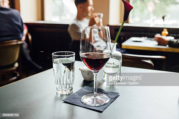 Close-Up Of Red Wine On Table At Restaurant