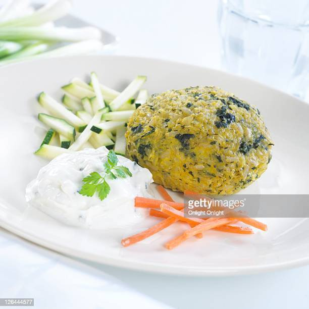 Close-up of rice ball with curd and carrots on plate