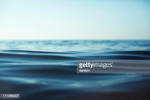 Close-up of rippling water surface against sky
