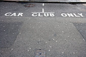 Close-Up of road marking saying Car Club Only in London, UK