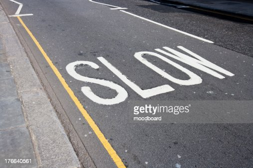 Close-Up of road marking saying Slow in London, UK : Stock Photo