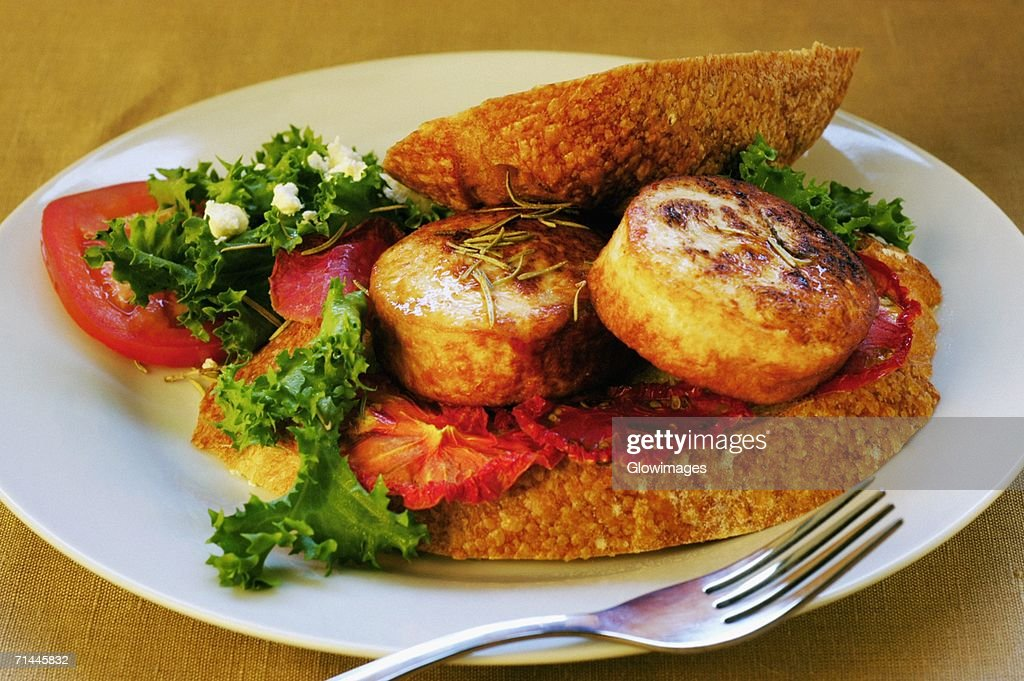 Close-up of roast meat and bread on a plate : Stock Photo
