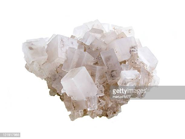 Close-up of rock salt against white background