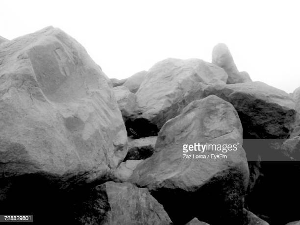 Close-Up Of Rocks Against Sky During Winter