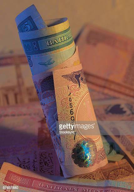 Close-up of rolled bank notes of Bahrain