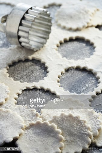 close-up of rolled pastry and cutter : Stock Photo
