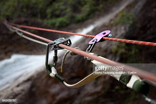 Close-Up Of Rope And Carabiner At Forest