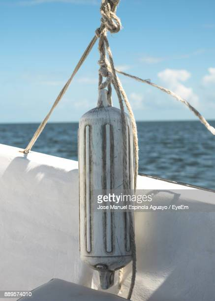 Close-Up Of Rope Tied On Boat Against Sea
