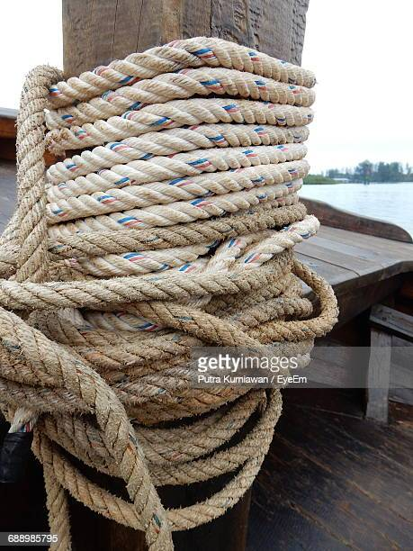 Close-Up Of Rope Tied On Bollard At Boat Deck
