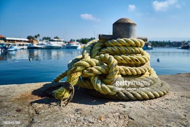 Close-Up Of Rope Tied On Pier