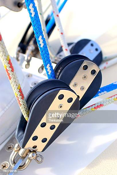 Close-up of ropes and pullies on a sailboat.